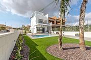 Недвижимость в Испании, Новые таухаусы рядом с гольф полем от застройщика в Вильямартин, Коста Бланка Torrevieja